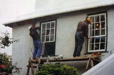 Workmen working on the windows