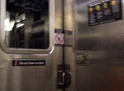 Sign in the train prohibiting walking between cars - New York City