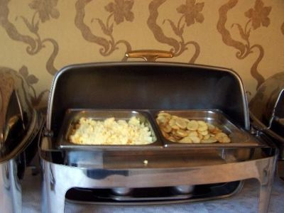 Scrambled eggs and fried potatoes