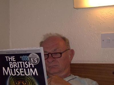 Bob reading in bed on the British Museum - a booklet from our daughter to prepare for tomorrow