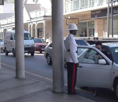 Nassau street scene - policeman giving ticket