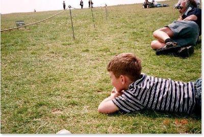 Grandson lying on the grass at Stonehenge