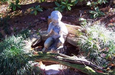 471305092084347-Statue_in_th..evil_Hills.jpg