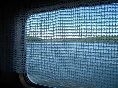 Looking out through a window screen or curtain