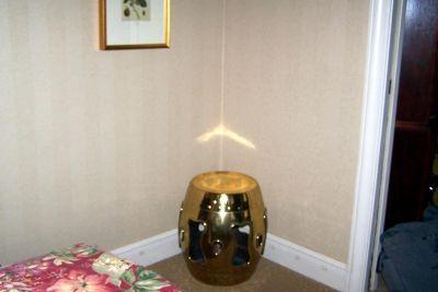 Object in corner of bedroom