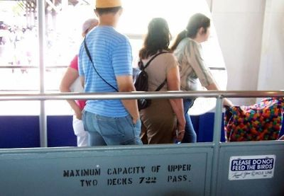 Signs on the boat and people getting off
