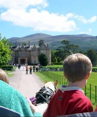 Muckross house from the back of a jaunting cart