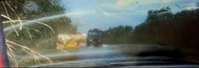 in the rain - oncoming bus