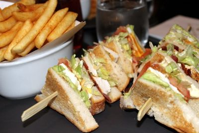 Cranberry juice and a club sandwich