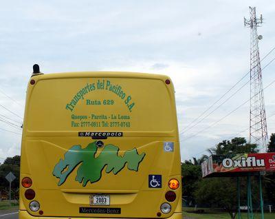 We drive behind a Quepos bus