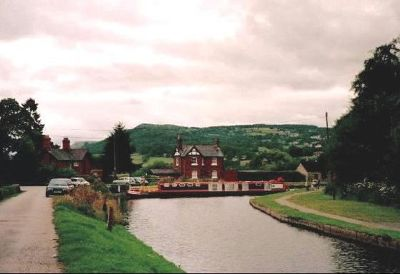 Canal boat in the turning basin turns to go back