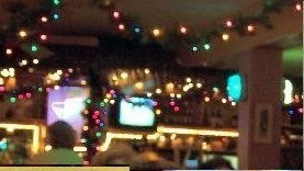 Restaurant inside with TVs and Xmas decorations