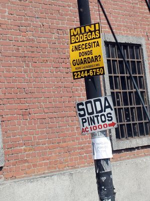 Signs on poles - A Soda is family-run restaurant like a diner in the USA