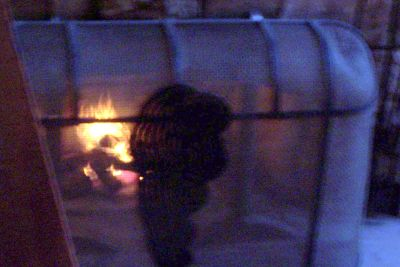 Fire with Old Faithful silhouetted on fire screen