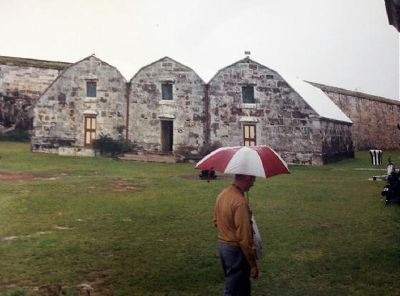 Bob 1995 walking between buildings in the rain