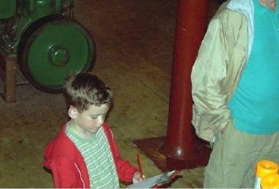 Grandson marking his answer sheet
