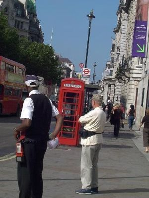 Bob waiting for the Big Bus with phone box in back