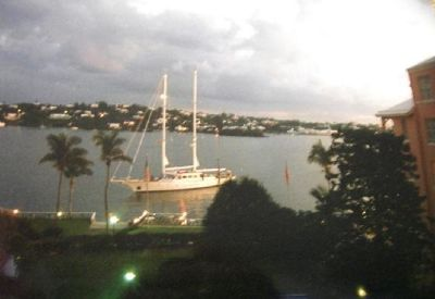 Yacht coming in at dusk from our window