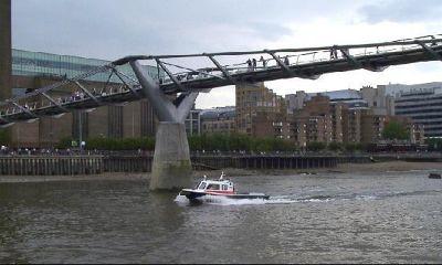 Millenium bridge with police boat
