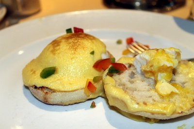 two poached eggs on an English muffin (Eggs Benedict) without the ham/Canadian bacon - I ate one egg before I took the photo