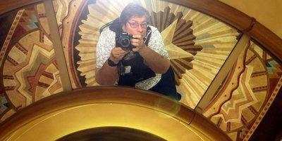 Selfie in a ceiling mirror