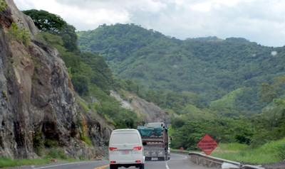 Workers on road ahead