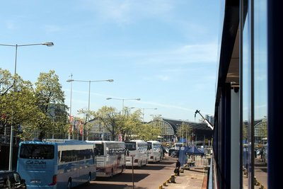 Buses bringing passengers - from our window