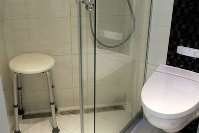 Shower stool (and toilet on the right)