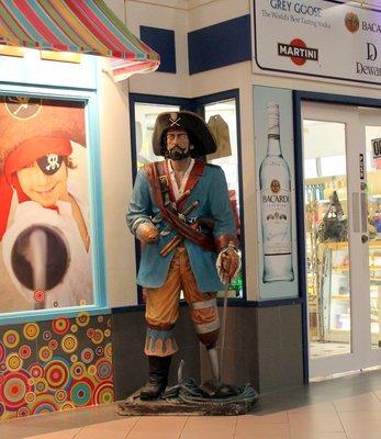 Pirate outside a shop