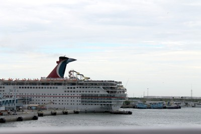 Carnival Dream and people lining the deck of Carnival Ecstasy