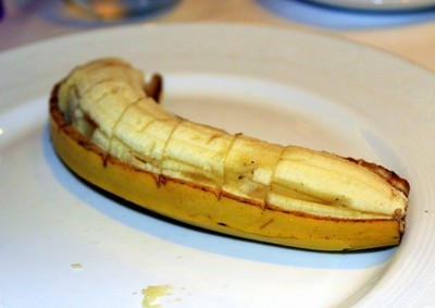 Banana which arrived sliced on a half of the skin