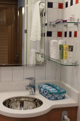 Granddaughters stuff in bathroom with shower/tub