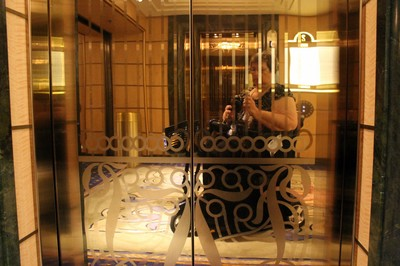me dressed for Formal Night reflected in the elevator doors