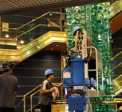 Cleaning the atrium sculpture