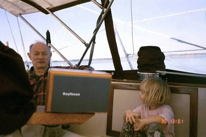 Bob and granddaughter in cockpit