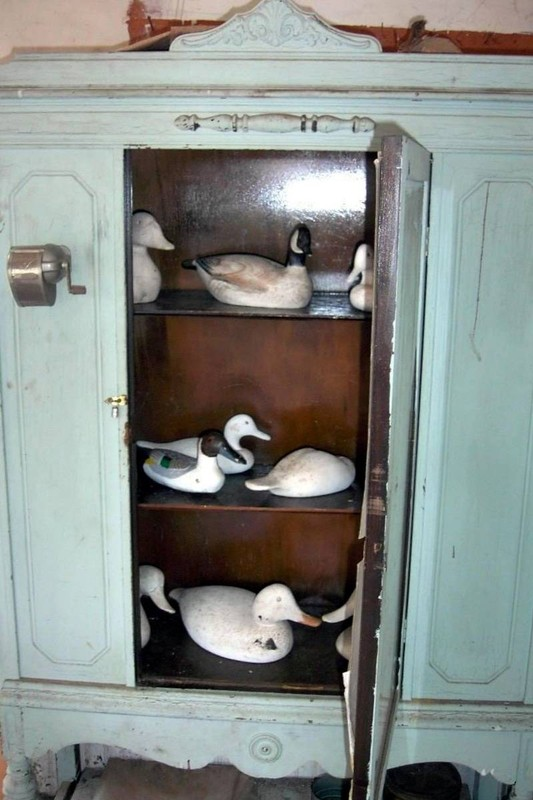 Duck decoys in the cabinet on the other side of finish workshop