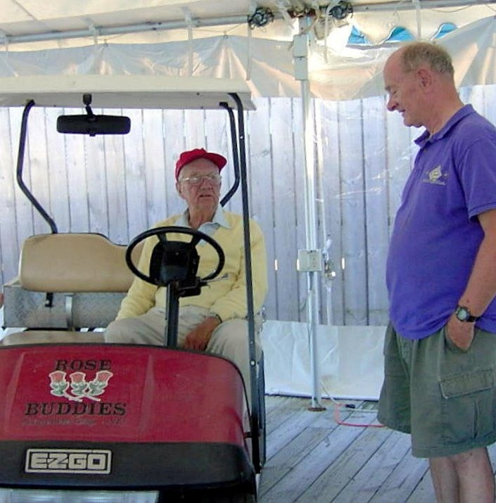 Fred Fearing in his Golf Cart, talks to Bob