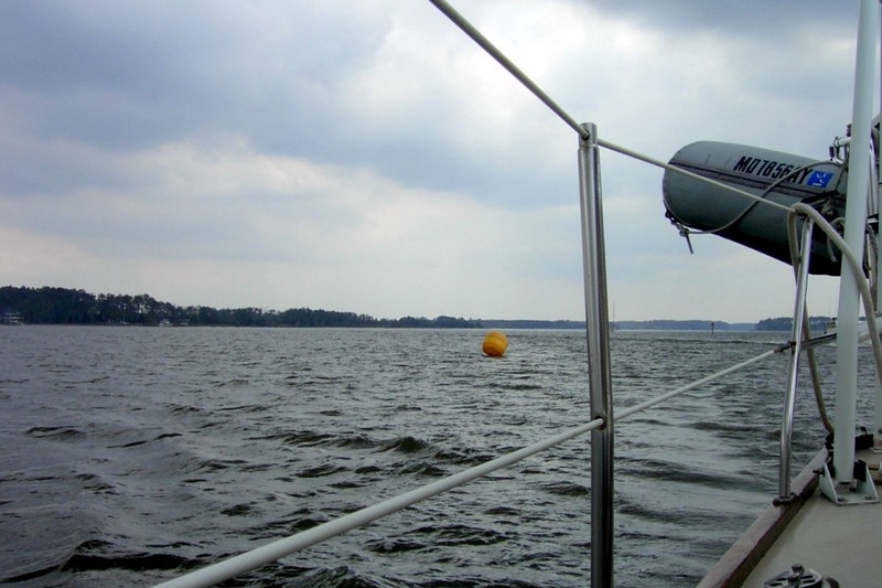 Floating yellow object -  may be a point for a sailboat race.
