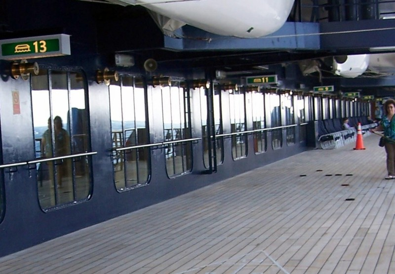 Promenade deck the next day with people playing shuffleboard