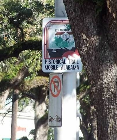 Historic Trail pointing to the U.S.S. Alabama in the harbor