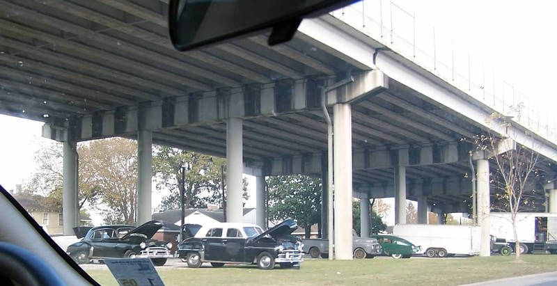 40's cars under an overpass