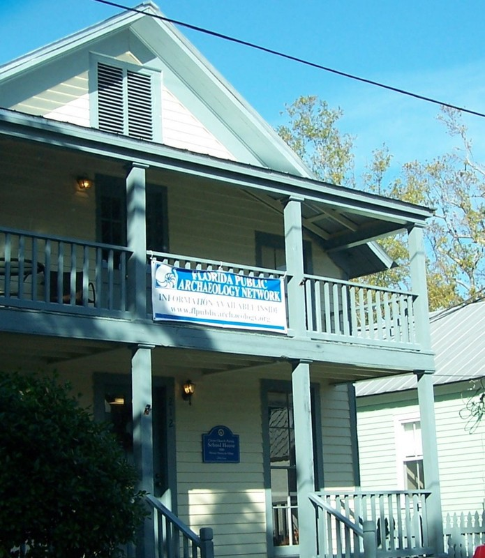 House with a banner for the Florida Public Archeology Network