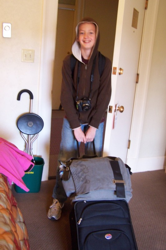 Grandson taking luggage out to the car from the Old Faithful Lodge