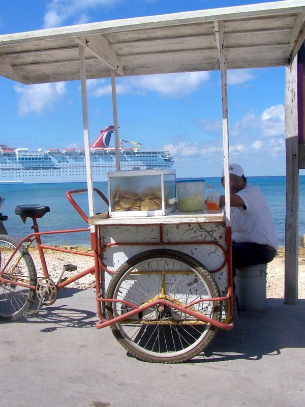 Bike peddler with Carnival Inspiration in the background