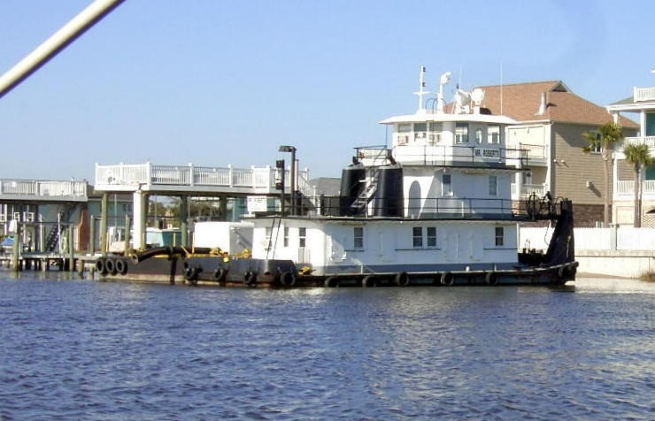 Tug parked at a private dock