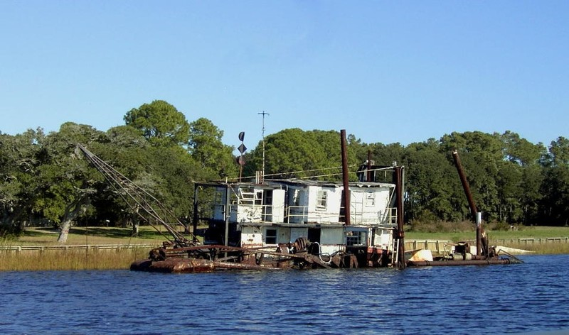 Barge with a dredge
