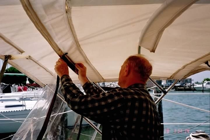 Bob putting up the bimini side curtain