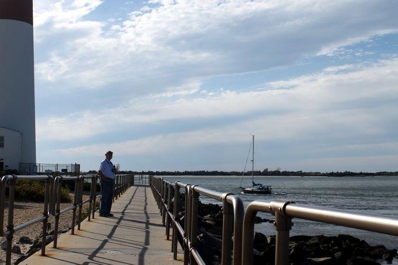 Bob watching sailboat rounding the lighthouse