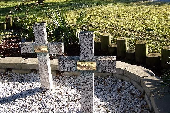 Two of the granite memorial crosses