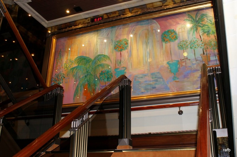 Modern painting at the top of the stairs